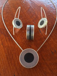 Contemporary Silver, damascus steel and ebony wood collection