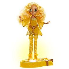 Leona Starling - Star Darlings Doll - 10 1/2'' | Disney Store Star Darlings' golden teen looks totally precious in her striking outfit which is even more dazzling when illuminated by the light-up stand that comes with this Star-Glow Edition Leona Starling doll.