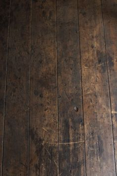 if we redid our floors i think they would look like this...gorgeous old dark weathered rustic wood floors
