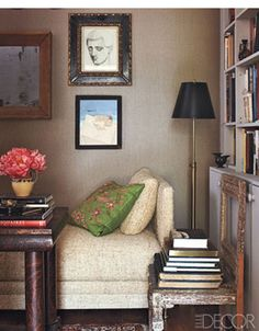 Bookcase Styling Ideas We Stole From the Pros : Use extra furniture, like a stylish vintage chair, to show off a stack of your favorite reads front and center. Grey Wall Color, Bookcase Styling, Vintage Chairs, Grey Walls, Elle Decor, Beautiful Interiors, Interiores Design, Decoration, Art Decor
