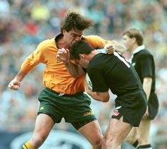 27 July 1996: Michael Brial going at it with All Black Frank Bunce in Brisbane. Bunce had the last laugh – he got on the scoresheet as New Zealand won 32-25. Photograph: SMH/Fairfax Media via Getty Images