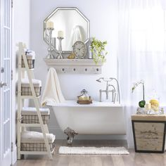 Pick A Theme For Your Bathroom To Narrow Decor Less Clutter More Calm Use Wall Shelves Vertical Storage Hooks Organize