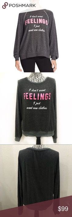 """Wildfox I Don't Want Feelings I Want New Clothes S Pit to pit 20"""" Sleeve 25.5"""" Shoulder 16"""" Length 23""""  Model is wearing a similar shirt, but not the exact same style. Wildfox Tops Tees - Long Sleeve"""