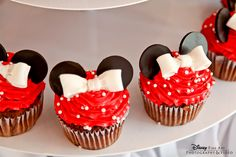 """Minnie Mouse cupcakes, complete with white polka dot sprinkles, white chocolate bow and chocolate """"ears"""""""
