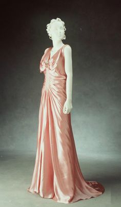 Evening dress of pink rayon satin crepe, c 1930.