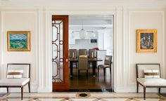 The kitchen and breakfast roomcan be concealed from the formal gallery by closing the polished French mahogany pocket doors, which feature hand drawn glass inserts.