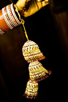 Wedding Kalireh- the shape of the kalirehs has a symbolic meaning. The top is shaped like a coconut, to show that the bride will always have food in her new home. There are metal pieces hanging from it, to show that she will always have wealth.