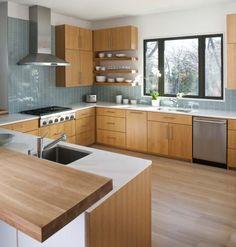 Modern, interesting. Maybe without a blue backsplash for a really warm kitchen.