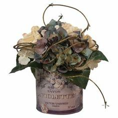 """Silk hydrangeas and budding vines in a French-themed glass pot.  Product: Faux floral arrangementConstruction Material: Silk, plastic and glassColor: Purple, blue, creme and greenFeatures: Includes faux hydrangeasDimensions: 9"""" H x 8"""" DiameterNote: For indoor use only"""