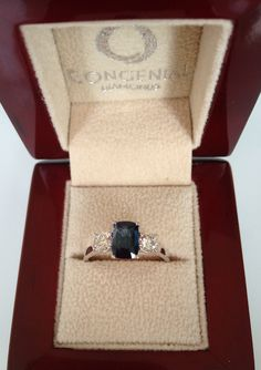 A three stone ring set with a sapphire and two round diamonds combining simplicity and elegance
