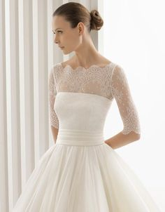 Reminds us of a ballerina and Audrey Hepburn.  It's a beautiful and simple dress.  Vintage Wedding Dresses | via Sortrature