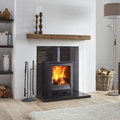 The Jens Keld 5 wood burning stove by Dik Geurts comes in two sizes; High and Low. The Keld Low is a great addition to an existing fireplace chamber due to it's 'snug' structure and shallow depth. The Keld High raises the stove up by which allows Log Burner Living Room, Home Living Room, Wood Burner Fireplace, Wood Burner Stove, Gas Stove, Inset Stoves, Wood Pellet Stoves, Morso Wood Stove, Ovens