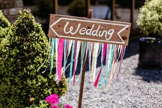 Lucy wore an Ellis Bridals gown for her quirky and colourful outdoor wedding. Photography by Cassandra Lane.