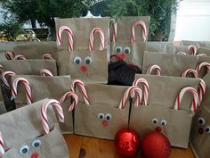 Reindeer gift bags--love the candy cane idea!