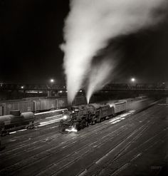 """""""Midnight Special"""". Freight train about to leave the Atchison,Topeka, and Santa Fe Railroad Yard for the West Coast - Argentine, Kansas - March, 1943 - photographer Jack Delano."""