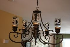 DIY Mason Jar Chandelier tutorial - easy 2 step directions.  I love this idea and it would be very pretty without the numbers to add a little sophistication as well.