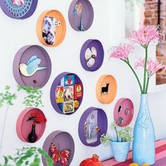 Hat box tops -paint them in bright colors. Install your accessories inside with a dab of glue, attach to the wall and voila!