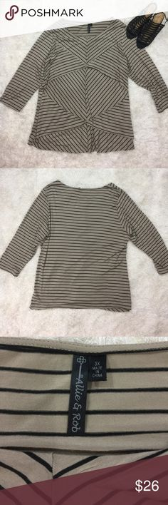 Plus size jersey tunic top 3X tan & black stripes Really nice striped layered jersey pullover tunic top. Plus size 3X. Length shoulder to hem 30 inches, armpit to armpit unstretched 24 inches. Excellent condition Allie & Rob Tops Tunics