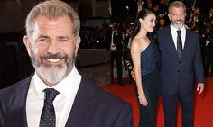 Mel Gibson strokes girlfriend Rosalind Ross at Blood Father premiere