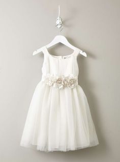 Flower girl dress inspiration: Such a cute dress with tulle skirt and sweet flower detail.