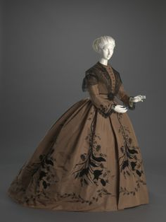 • Ensemble: Dress, Belt, Pelerine and Boots. Date: ca. 1866 Place of origin: prob. United States Medium: Silk, linen, cotton, leather, metal. From the Cincinnati Art Museum.