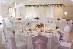 Ivory pealight cascade backdrop with artificial foliage, and Kate Spade inspired wallpaper table runners by www.stressfreehire,com #venuetransformers - photo by Weddings at Silvermere