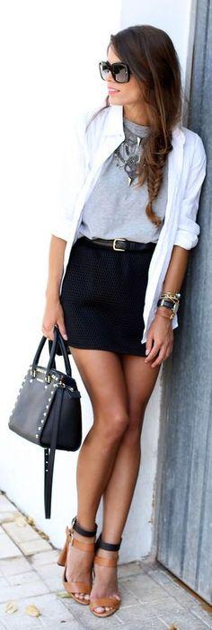 saia preta estampa bolinhas blusa cinza camisa branca sandália caramelo preta colar bolsa preta cinto preto
