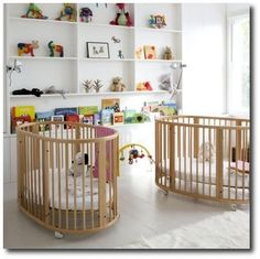 White is twice as nice when decorating a nursery for twins. Love the simple wall storage and the Stokke Sleepi cribs