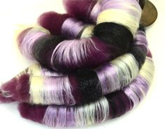 Silky rolags to fall in love with and spin.