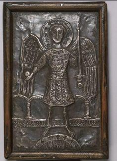 A twelfth-thirteenth-century portrayal of the Archangel Michael; he holds his sword attribute. (Museum of Russian Icons)