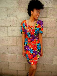 Very colorful and beautiful dress! Plus i like the fro-hawk!