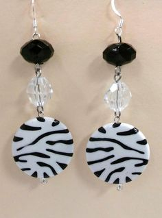 """Sometimes atouch of animal print can make the right outfit just pop! Crafted with silver non-tarnish wire and black, white & clear acrylic beads.I see a matching necklaces it these earrings near future!    To add this item to your collection simply comment below with your email address!    If mailed, shippingcharges will apply.    Message me if you live in Columbia, SC or close surrounding areas to set up a """"Meet & Deliver"""". 
