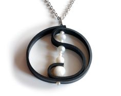 Upcycled motorcycle inner tube pendant with freshwater pearls by livelyleafdesigns! Find it on etsy for $35