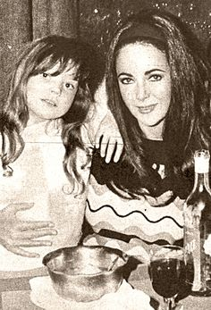 Elizabeth Taylor and daughter Maria Burton....Liz and the Daughter She Adopted With Husband, Richard Burton...Despite Liz's Many Marriages, Romances and Her Busy Career, She Remained A Hands-On and Always Available Mother & Grandmother, According to Her Friends and Her Children....Look At That Warm Hugs Mom Is Giving Lisa...