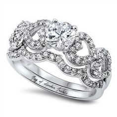 This Perfect 1CT Round Cut Russian Lab Diamond Bridal Set is intricately designed with diamond accented hearts and has amazing sparkle. It's new for 2017 and one of my favorites. Take a look of the pi