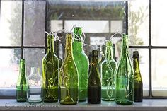Window+sill+decoration+with+a+group+of+green+bottles+and+a+light+string.+Songbirdblog.com