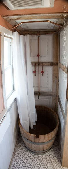 Cool plumbing and shower curtain rod!   ---Tiny-Craftsman-House-winebarrel-shower