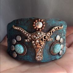 Longhorn Patina Bracelet Rhinestone and faux turquoise embellished faux patina bracelet with brass color Longhorn head. Beaded faux leather pull straps tighten and loosen. Brand new for boutique retail. No trades, no holding, no offsite payment.        🗣 PRICE IS FIRM UNLESS BUNDLED No offers entertained. 💙5% Off Bundles💚 Jewelry Bracelets