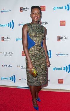 Lupita Nyong'o Cocktail Dress - Lupita Nyong'o looked like a jewel at the GLAAD Media Awards in an iridescent green Antonio Berardi dress with electric-blue waist accents. Lupita Nyongo, Beaded Clutch, Electric Blue, Style Icons, Peplum Dress, Celebrity Style, Awards, Formal Dresses, Celebrities