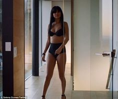 Daring to bare: Selena Gomez flashes some skin in black lingerie in a teaser for her upcoming Hands To Myself music video