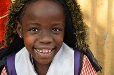 mollyinkenya:  Sweet smile | Kibera | Nairobi | Kenya. Photography bymollyinkenya.