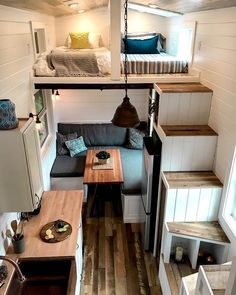 Tiny Heirloom ~ Dual lofts, one on each end of the tiny home with dueling staircases up to them. One for the kiddos(or guests) and one for the parents - can't get much better than that!