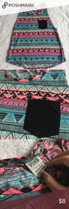 Victoria's Secret PINK Multicolored Tribal Tank! This is a listing for a VS PINK tank top. This is a cute tank top that is multicolored (pinks, blues, purple, etc) with a fun aztec/tribal black print. This is a size medium, and while it has been worn, it is in excellent condition. This is cute with a bralette. This can make a breezy summer outfit! The last photo is not of my shirt, but it is the same style tank top and it shows the fit. PINK Victoria's Secret Tops Tank Tops