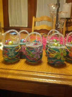 my 3 year old and i made these cute baskets for her dance Easter party. Its simple,fun, affordable and the variations are endless. we wrapped yarn around a baby food jar(we wrapped different directions but you can do circular as well) securing it with hot glue in various places glued pipe cleaners as the handle and a flower on the front,stuffed it with easter hay and candy.You can change the colors up for different holidays or for your little girls birthday party favors! Fun and easy...