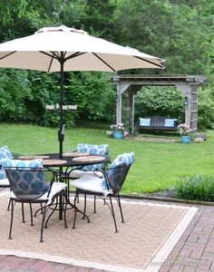 Simply adding a new umbrella, outdoor rug, and chair cushions completely transformed this outdoor space. We're ready to kick back and relax this summer! Outdoor Rooms, Outdoor Gardens, Outdoor Living, Outdoor Decor, Outdoor Ideas, Iron Patio Furniture, Outdoor Furniture Sets, Backyard Makeover, Backyard Retreat
