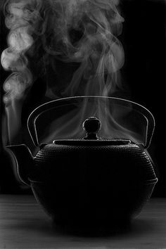 A steaming tea pot.