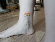 "Client wanted a customized small tattoo : rain + sun = rainbow. It reminds me of the quote: ""Everybody wants happiness, nobody wants pain. You can't have a rainbow without a little rain"". I'm just so in the right mood to do a rainbow tattoo at the..."