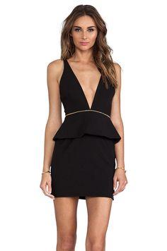Deep V neck low cut peplum mini dress! I'd wear this if I lost weight.