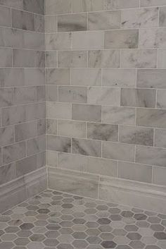 Large gray and white marble subway tile on shower wall and baseboard with a hexagon pattern on the floor. Large gray and white marble subway tile on shower wall and baseboard with a hexagon pattern on the floor. Upstairs Bathrooms, Dream Bathrooms, Basement Bathroom, Beautiful Bathrooms, Bathroom Flooring, Tiled Bathrooms, Gray Tile Bathrooms, Bathroom Furniture, Cottage Bathrooms