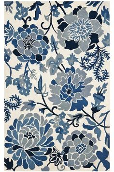 Vibrant blooms in a cool blue palette wind their way across our Martha Stewart Living™ Dreamy Floral Area Rug. This lush, handmade rug complements traditional and contemporary decorating concepts.  Hand loomed of 100% wool.  Thick, plush pile.